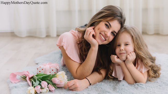 Cute Smiling Faces of Mom Daughter with Flowers